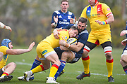 USA player Nick Civetta tackles a Romanian ball carrier in the first half during the November Test match between Romania and USA at Ghencea Stadium, Bucharest, Romania on 17 November 2018.