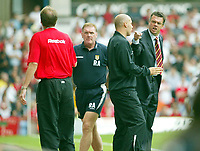 Photograph: Scott Heavey.<br />Aston Villa V Liverpool. FA Barclaycard Premiership match from Villa Park. 24/08/2003.<br />David O'Leary and Phil Thompson collide in the dugout area.