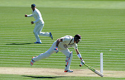 Surrey's Kevin Pietersen survives a near run out.  - Photo mandatory by-line: Harry Trump/JMP - Mobile: 07966 386802 - 22/04/15 - SPORT - CRICKET - LVCC County Championship - Division 2 - Day 4 - Glamorgan v Surrey - Swalec Stadium, Cardiff, Wales.