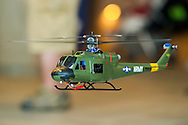 Huey UH-1 Helicopter remote control model, with collective pitch like a real helicopter, is flying at the 8th Annual Flying Model Show sponsored by Academy of Model Aeronautics (AMA) and Model Airplane Clubs of Nassau, Suffolk & Queens, in the lobby of the Cradle of Aviation Museum.