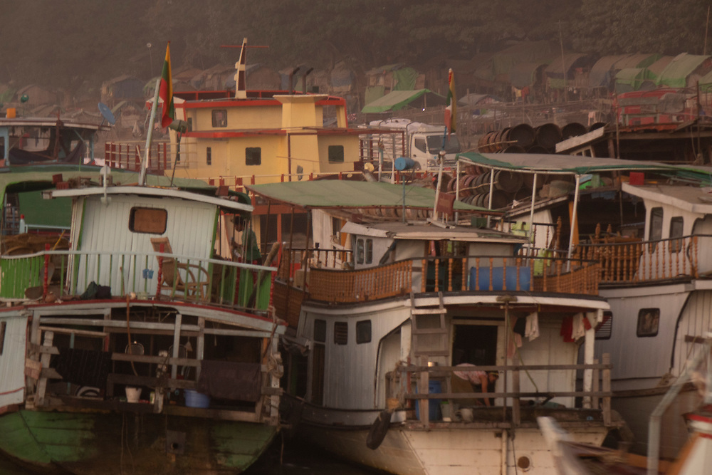 Photograph boats jammed together on the Irrawaddy River, Myanmar