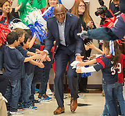 Former NFL great Donald Driver is greeted by students during the Houston launch of the Character Playbook, a joint initiative of the NFL and the United Way Worldwide at Pilgrim Academy, February 3, 2017.