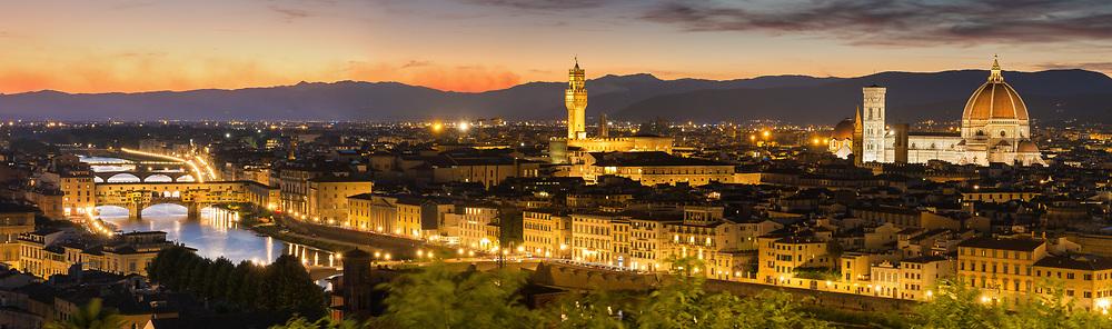 From left to right: Arno river and Ponte Vecchio bridge, tower of Palazzo Vecchio, and the Duomo.