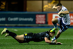 Harri Millard of Cardiff Blues evades the tackle of George Turner of Glasgow Warriors<br /> <br /> Photographer Simon King/Replay Images<br /> <br /> Guinness PRO14 Round 15 - Cardiff Blues v Glasgow Warriors - Saturday 16th February 2019 - Cardiff Arms Park - Cardiff<br /> <br /> World Copyright © Replay Images . All rights reserved. info@replayimages.co.uk - http://replayimages.co.uk
