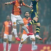 Galatasaray's Yekta Kurtulus (L) and Fenerbahce's Emre Belozoglu (R) during their Turkish superleague soccer derby match Galatasaray between Fenerbahce at the AliSamiYen spor kompleksi TT Arena in Istanbul Turkey on Sunday, 06 April 2014. Photo by Aykut AKICI/TURKPIX