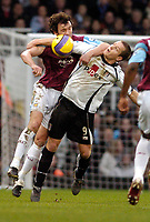 Photo: Leigh Quinnell.<br /> West Ham United v Fulham. The Barclays Premiership. 13/01/2007. West Hams Christian Dailly knocks Fulhams Heidar Helguson out of the way.