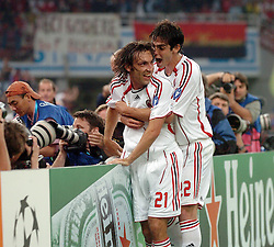 Athens, Greece - Wednesday, May 23, 2007: AC Milan's Andrea Pirlo and Kaka celebrate the opening goal scored by Kaka, after free kick got deflected by Filippo Inzaghi, during the UEFA Champions League Final against Liverpool at the OACA Spyro Louis Olympic Stadium. (Pic by Jason Roberts/Propaganda)