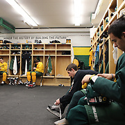 Hamden High School ice hockey players, from left,  Eric Perez,  Sam Carignan, Patrick Coleman and Matthew Pantera, prepare for a training session at Hamden High School,  Hamden, Connecticut, USA. 20th February 2014. Photo Tim Clayton