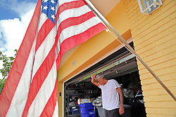 Bill Schumacher wipes the sweat from his eyes while securing his Lauderdale-By-The-Sea home in preparation for Hurricane Irma on Friday, Sept. 8, 2017. (Photo by Amy Beth Bennett /Sun Sentinel/TNS/Sipa USA)<br />