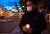 Bialystok, 17.05.2020. Protest pod bialostocka kuria archidiecezjalna pod haslem DOSC ZABAWY W CHOWANEGO, przez co dzialacze Lewicy chca okazac solidarnosc z ofiarami ksiezy pedofili N/z Pawel Krutul ( P ) posel Lewicy ze swieczka, w tle pomnik papieza Jana Pawla II fot Michal Kosc / AGENCJA WSCHOD