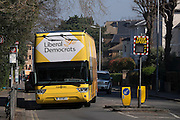 © Licensed to London News Pictures. 06/04/2015. Surbiton, UK. The campaign bus arrives.  Liberal Democrat Leader and Deputy Prime Minister NICK CLEGG and climate secretary ED DAVEY campaigning for votes in the general election in Ed Davy's constituency of Surbiton today 6th April 2015. Photo credit : Stephen Simpson/LNP