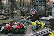 Preparing for All Saints Day. Powazek Cemetery. Warsaw, Poland. Aleksandra Goldanowska.