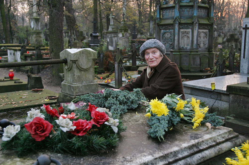 Preparing for All Saints Day. Powazek Cemetery. Warsaw, Poland. Aleksandra Goldanowska.