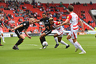 Doncaster Rovers forward Mallik Wilks (7) and Doncaster Rovers forward John Marquis (9) push forward against Portsmouth FC defender Anton Walkes (2) and Portsmouth FC defender Jack Whatmough (16) during the EFL Sky Bet League 1 match between Doncaster Rovers and Portsmouth at the Keepmoat Stadium, Doncaster, England on 25 August 2018.Photo by Ian Lyall.