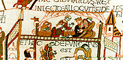 Bayeux Tapestry 1067. Death of Edward the Confessor, King of England from 1042, on 5 January 1066.  Above on his deathbed talking to courtiers in cluding Harold. Below, dead with priest in attendance. Anglo-Saxon Textile  Linen