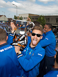 Bristol Rovers' Matt Taylor celebrates with the Vanarama Play-Off final trophy on the celebration Bus Tour parade  - Photo mandatory by-line: Dougie Allward/JMP - Mobile: 07966 386802 - 25/05/2015 - SPORT - Football - Bristol - Bristol Rovers Bus Tour
