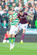 Mikael Lustig(#23) of Celtic FC challenges Steven MacLean (#18) of Heart of Midlothian during the Betfred League Cup semi-final match between Heart of Midlothian FC and Celtic FC at the BT Murrayfield Stadium, Edinburgh, Scotland on 28 October 2018.