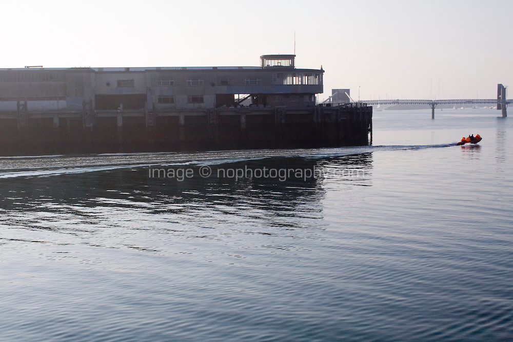 An inflatable dingy goes past the Carlisle Pier in Dun Laoghaire, Dublin Ireland