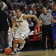 Kia Nurse, (left), UConn, drives to the basket past Brittany Hrynko, DePaul, during the UConn Vs DePaul, NCAA Women's College basketball game at Webster Bank Arena, Bridgeport, Connecticut, USA. 19th December 2014