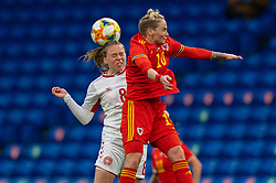 CARDIFF, WALES - Tuesday, April 13, 2021: Denmark's Emma Snerle (L) challenges for a header with Wales' Jessica Fishlock during a Women's International Friendly match between Wales and Denmark at the Cardiff City Stadium. (Pic by David Rawcliffe/Propaganda)