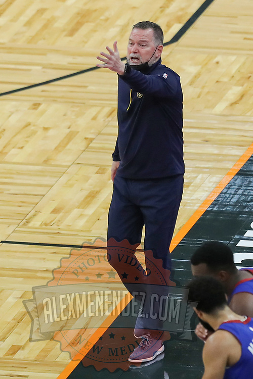 ORLANDO, FL - MARCH 23:  Denver Nuggets head coach Michael Malone gives instructions against the Orlando Magic at Amway Center on March 23, 2021 in Orlando, Florida. NOTE TO USER: User expressly acknowledges and agrees that, by downloading and or using this photograph, User is consenting to the terms and conditions of the Getty Images License Agreement. (Photo by Alex Menendez/Getty Images)*** Local Caption *** Michael Malone
