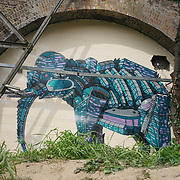 London,England,UK : 11th April 2016 : 'Endangered 13' Project, Andy Council street artists painting  'Elephant' raising awareness Endangered animal at Ackroyd Drive, Sponsor by Tower Hamlets council in London. Photo by See Li