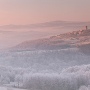 Montpeyroux in fist sunlight in winter frost scenery. Auvergne, France