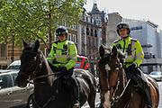 Metropolitan Police Cavalry Service, is seen patrolling near Downing Street in London, on Tuesday, May 5, 2020. (Photo/Vudi Xhymshiti)