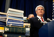 U.S. House Speaker Newt Gingrich during a press conference with stacks of federal budgets in support of a balanced budget amendment February 5, 1997 in Washington, DC.
