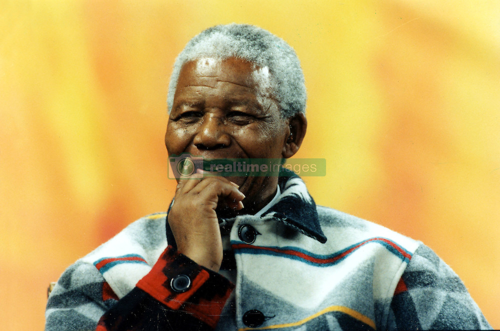 September 25, 1988 - Toronto, Ontario, Canada - Young at Heart: South African President NELSON MANDELA, dressed in fleece jackets given to him by aboriginal leaders; smile with delight as they enter a SkyDome filed to the rafters with more than 40,000 schoolchildren. (Credit Image: Ken Faught/Toronto Star/ZUMAPRESS.com)