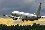 The Boeing P-8 Poseidon (formerly the Multimission Maritime Aircraft or MMA) is a military aircraft developed for the United States Navy (USN). The aircraft has been developed by Boeing Defense, Space & Security, modified from the 737-800ERX. The P-8 conducts anti-submarine warfare (ASW), anti-surface warfare (ASUW), and shipping interdiction, along with an early warning self-protection (EWSP) ability, otherwise known as electronic support measures (ESM). This involves carrying torpedoes, Harpoon anti-ship missiles, and other weapons.. Photographed at Royal International Air Tattoo (RIAT)