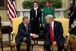 United States President Donald J. Trump shakes hands with King Abdullah II of Jordan in the Oval Office of the White House in Washington, DC on Wednesday, April 5, 2017.  Standing behind the President and  King are Queen Rania of Jordan, left, and first lady Melania Trump, right.<br /> Credit: Ron Sachs / Pool via CNP *** Please Use Credit from Credit Field ***