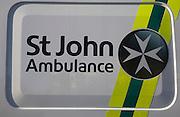 Close up St John Ambulance sign on vehicle, UK