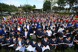 © Licensed to London News Pictures. 16/06/2017. Birstall, UK.  Over 500 school children from nine schools in the Birstall area that have joined together in Heckmondwike Green to sing songs in memory of MP Jo Cox this morning. Today marks the one year anniversary of the death of Labour MP for Batley & Spen Jo Cox. Jo Cox died after being shot & stabbed by Thomas Mair outside Birstall library where she had been due to hold a constituency surgery. Photo credit: London News Pictures