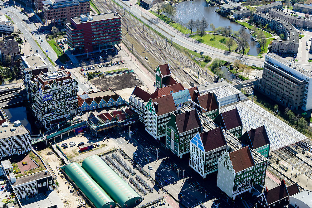 Nederland, Noord-Holland, Zaandam, 20-04-2015; Inverdan, nieuwe stadscentrum Zaandam, masterplan Sjoerd Soeters. Station en Stadhuis rechts, links  het Zaanse huisjeshotel - Inntel Hotel - is een ontwerp Wilfried van Winden.<br /> New center of the city of Zaandam, developed according to the master plan by architect Sjoerd Soeters. Train station and city hall. The hotel built in a postmodern version of the style of the historic houses of Zaandam - Inntel Hotel - was designed by Wilfried van Winden.<br /> luchtfoto (toeslag op standard tarieven);<br /> aerial photo (additional fee required);<br /> copyright foto/photo Siebe Swart
