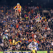 Andrew Short, (top left), KTM, and Eli Tomac, (top right), Honda, in action during the final of the 450SX Class Championship during round 16 of the Monster Energy AMA Supercross series held at MetLife Stadium. 62,217 fans attended the event held for the first time at MetLife Stadium, New Jersey, USA. 26th April 2014. Photo Tim Clayton