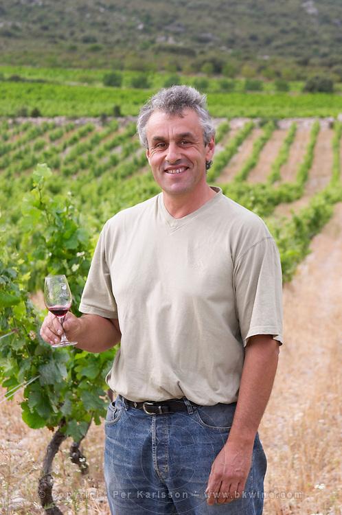 Alain Caujolle-Gazet Domaine des Grecaux in St Jean de Fos. Montpeyroux. Languedoc. Owner winemaker. France. Europe. Wine glass. Vineyard.