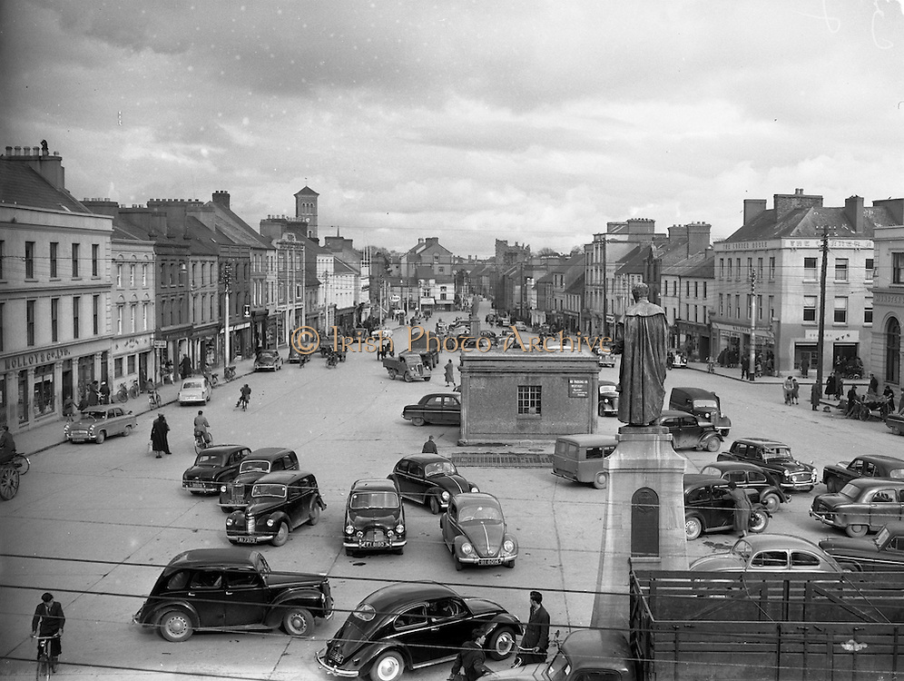 30/03/1957 <br /> Views of towns in Ireland. Liberty Square, Thurles, Co. Tipperary with Statue memorial to Archbishop Croke.