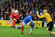 Cardiff city's Heidar Helguson (l) chips over keeper Robert Olejnik but sees his effort go inches wide of goal. NPower championship, Cardiff city v Peterborough Utd at the Cardiff city stadium in Cardiff, South Wales on Sat 15th Dec 2012. pic by Andrew Orchard, Andrew Orchard sports photography,