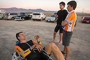 Sebastiaan Bowier (liggend) praat met Jan Bos en trainer Niels na over zijn race. In de buurt van Battle Mountain, Nevada, strijden van 10 tot en met 15 september 2012 verschillende teams om het wereldrecord fietsen tijdens de World Human Powered Speed Challenge. Het huidige record is 133 km/h.<br /> <br /> Sebastiaan Bowier is evaluating his race with Jan Bos and trainer Niels. Near Battle Mountain, Nevada, several teams are trying to set a new world record cycling at the World Human Powered Vehicle Speed Challenge from Sept. 10th till Sept. 15th. The current record is 133 km/h.