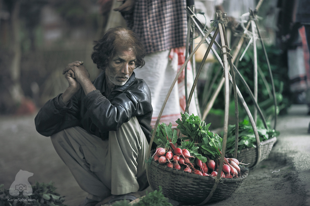 A man contemplates the fruit of his labour, at the Hinimari market. The Bhramaputra river which crosses Assam make it a remarkably fertile state.