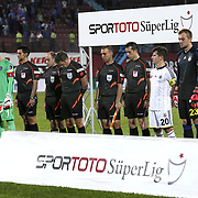 Referee's Firat Aydinus (C)  during their Turkish SuperLeague Derby match Trabzonspor between Fenerbahce at the Avni Aker Stadium at Trabzon Turkey on Sunday, 14 September 2014. Photo by Aykut AKICI/TURKPIX
