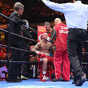 Luis Collazo sits in his corner as referee Telis Assimenios stops the fight against Keith Thurman during their Premier Boxing Champions boxing match for the WBA Welterweight title on ESPN at the USF Sun Dome, on Saturday, July 11, 2015 in Tampa, Florida.  Thurman won the bout when the corner of Collazo stopped the fight at the beginning of the eighth round. (AP Photo/Alex Menendez)