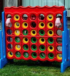 Pictured: <br />Scottish Liberal Democrat Leader Willie Rennie announced plans for mental health first aiders by playing a giant game of Connect 4.. He was joined by Rebecca Bell and her 18 month old daughter Daphne.<br /><br />Ger Harley | EEm 1 April 2021