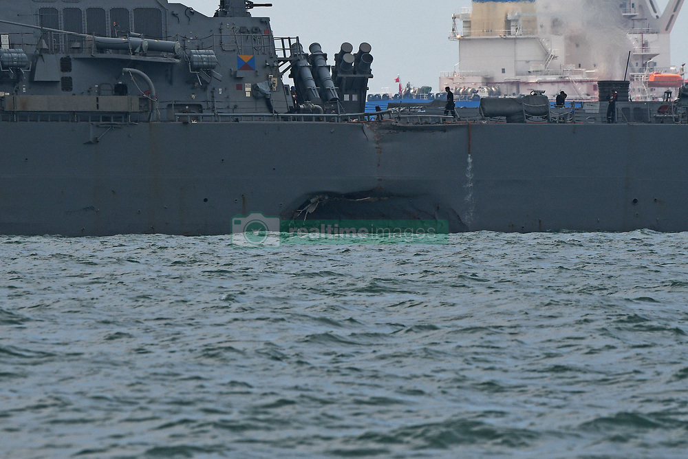 Aug. 21, 2017 - Singapore, Singapore - The damage is visible on the USS John S. McCain as it is seen at sea off Singapore's Changi Naval Base. Ten sailors were missing and five others injured after the guided-missile destroyer USS John S. McCain collided with a merchant vessel in waters east of the Straits of Malacca and Singapore early on Monday, the U.S. navy said in a statement. (Credit Image: © Then Chih Wey/Xinhua via ZUMA Wire)