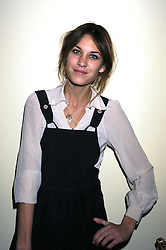 ALEXA CHUNG at the opening of the Atelier Moet pop-up boutique, 70 New Bond Street, London on 3rd December 2008.