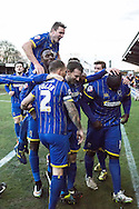 Team Celebrate David Connolly's injury time winner during the Sky Bet League 2 match between AFC Wimbledon and Luton Town at the Cherry Red Records Stadium, Kingston, England on 21 February 2015. Photo by Stuart Butcher.