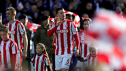 Stoke City's Kevin Wimmer walks out with his team-mates and mascots for the Premier League match at the bet365 Stadium, Stoke-on-Trent.