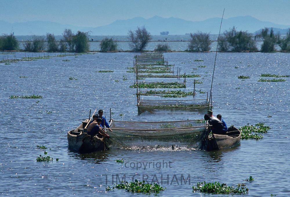 Fishermen lifting netson Lake Dianchi, Kunming, China