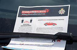 © Licensed to London News Pictures; 05/04/2020; Bristol, UK. Coronavirus Pandemic 2020; Avon & Somerset police are leaving notices on cars parked near the Clifton Suspension Bridge during the UK wide coronavirus lockdown with the biggest restrictions on freedom of movement ever imposed in the UK. The notices ask if the journey is essential. Police are patrolling parks and open spaces, and people are told to stay at home except for essential work that cannot be done at home, shopping for food, medical appointments and taking exercise once a day all while maintaining social distance. Photo credit: Simon Chapman/LNP.